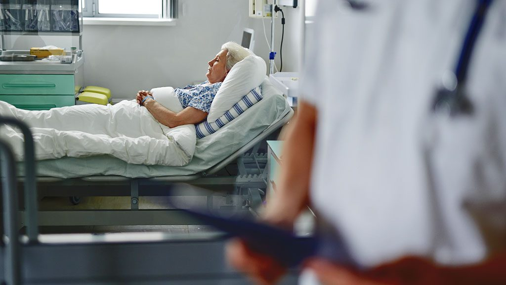 Senior woman lying in icu