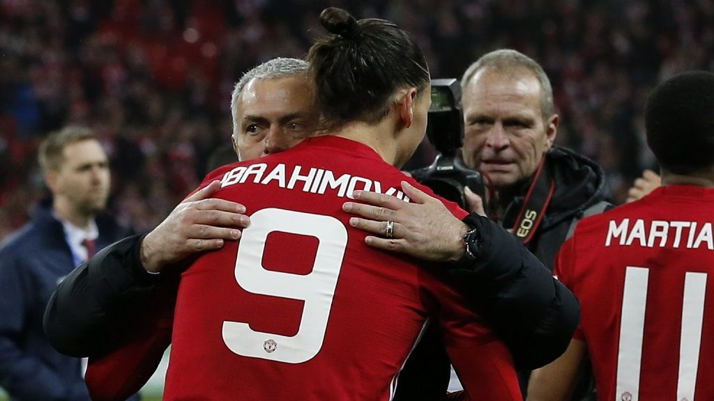 Manchester United's Swedish striker Zlatan Ibrahimovic embraces Manchester United's Portuguese manager Jose Mourinho as players celebrate on the pitch after their victory in the English League Cup final football match between Manchester United and Southampton at Wembley stadium in north London on February 26, 2017. Zlatan Ibrahimovic sealed the first major silverware of Jose Mourinho's Manchester United reign and broke Southampton's hearts as the Swedish star's late goal clinched a dramatic 3-2 victory in Sunday's League Cup final. / AFP PHOTO / Ian KINGTON / RESTRICTED TO EDITORIAL USE. No use with unauthorized audio, video, data, fixture lists, club/league logos or 'live' services. Online in-match use limited to 75 images, no video emulation. No use in betting, games or single club/league/player publications.  /