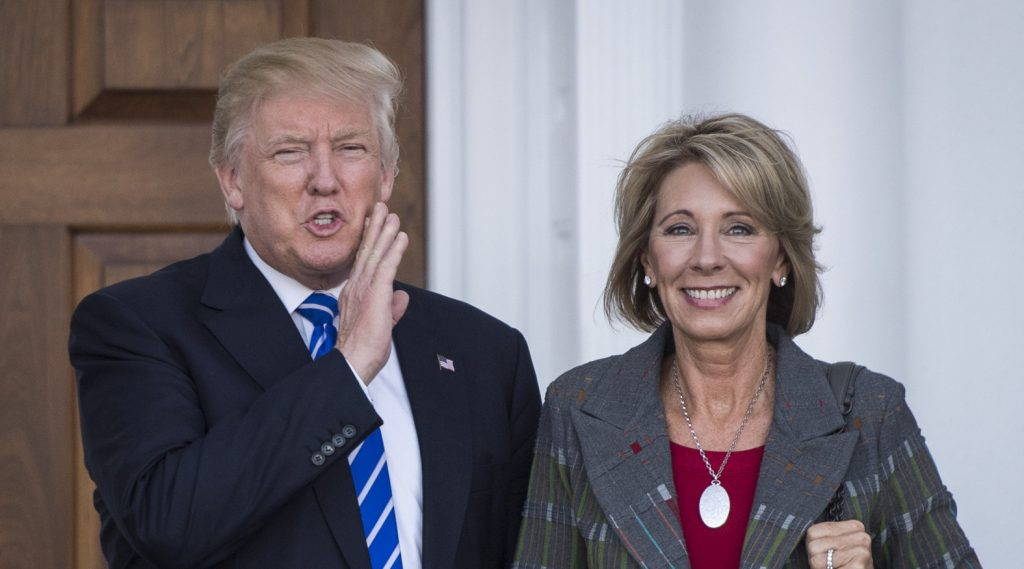 BEDMINSTER TOWNSHIP, NJ - NOVEMBER 19: President-elect Donald Trump stands with Betsy DeVos after a meeting at Trump National Golf Club Bedminster in Bedminster Township, N.J. on Saturday, Nov. 19, 2016. (Photo by Jabin Botsford/The Washington Post via Getty Images)