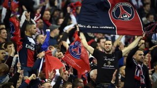 Paris' supporters cheer their team prior to the French League Cup final football match between Paris Saint-Germain (PSG) and Lyon (OL) on April 19, 2014 at the Stade de France in Saint-Denis, north of Paris. AFP PHOTO / FRANCK FIFE        (Photo credit should read FRANCK FIFE/AFP/Getty Images)