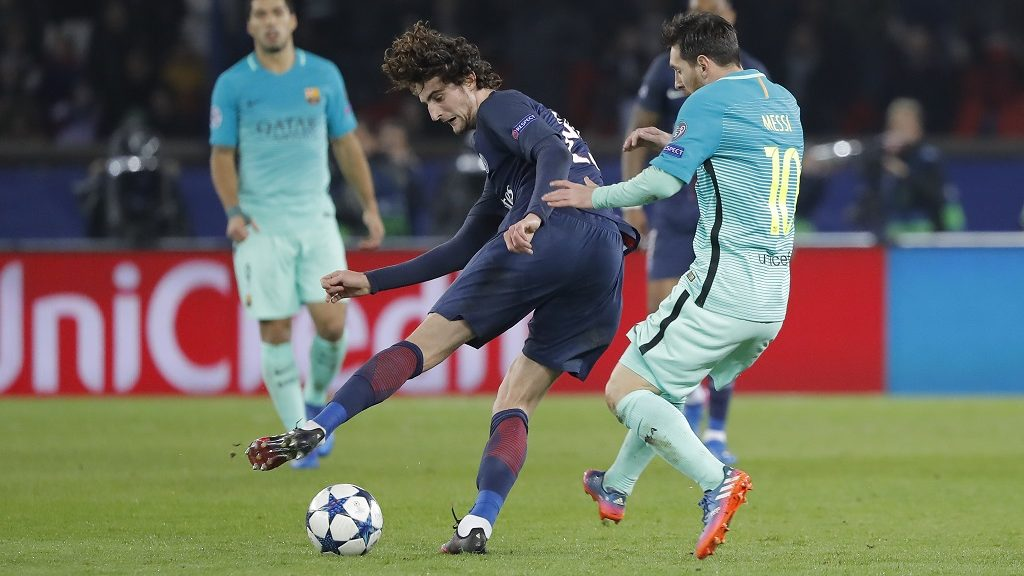 Adrien Rabiot (psg) battled for the ball against Lionel Messi (FC Barcelona) during the UEFA Champions League, round of 16, 1st leg between Paris Saint-Germain and FC Barcelona on february 14, 2017 at Parc des Princes stadium in Paris, France - Photo Stephane Allaman / DPPI