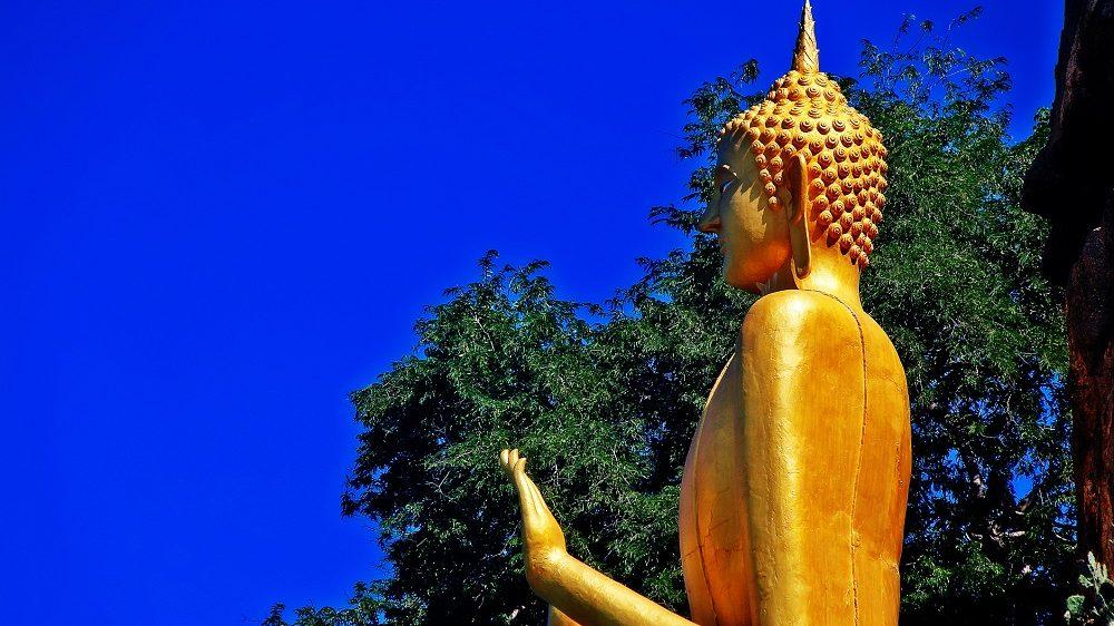 Golden Buddha statue in Khao Takiab temple at Khao Takiab mountain (also known as Monkey mountain or Chopstick mountain), Hua Hin district, Prachuap Khiri Khan, Thailand.