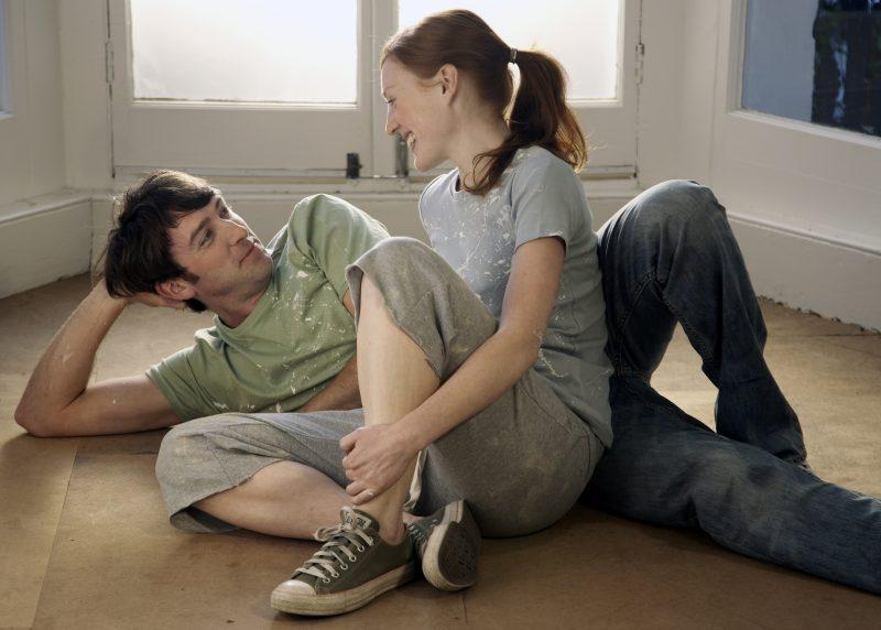 Couple relaxing on an empty floor
