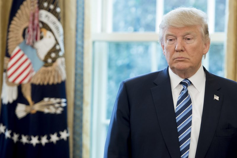 US President Donald Trump stands in the Oval Office of the White House in Washington, DC, February 9, 2017, following the swearing-in of US Attorney General Jeff Sessions. / AFP PHOTO / SAUL LOEB