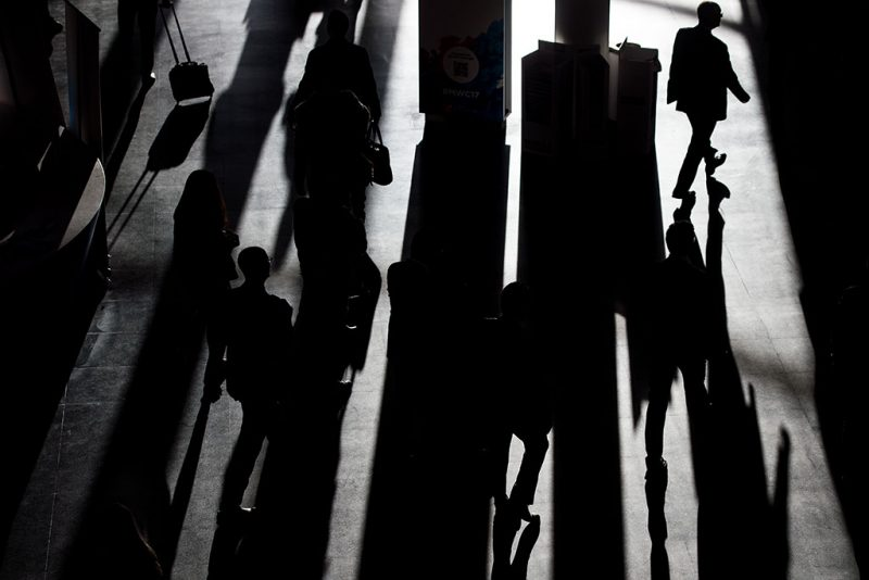 Visitors leave at the Mobile World Congress on the second day of the Mobile World Congress in Barcelonaon on February 28, 2017.Phone makers will seek to seduce new buyers with artificial intelligence functions and other innovations at the world's biggest mobile fair starting today in Spain. / AFP PHOTO / Josep Lago