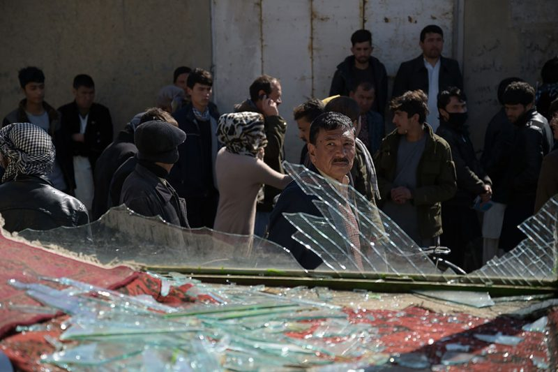 An Afghan man looks on at the site of a suicide car bombing in Kabul on March 1, 2017.Explosions and gunfire echoed through Kabul in two separate Taliban assaults on security compounds on March 1, officials said, as the insurgents ramp up attacks before the start of their annual spring offensive. / AFP PHOTO / SHAH MARAI