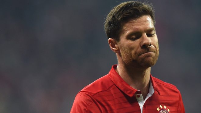 (FILES) This file photo taken on February 15, 2017 shows Bayern Munich's Spanish midfielder Xabi Alonso during the UEFA Champions League round of sixteen football match between FC Bayern Munich and Arsenal in Munich, southern Germany. Bayern Munich's Spanish midfielder Xabi Alonso announced on March 9, 2017 thta he will end his football career at the end of the current season. / AFP PHOTO / Christof STACHE