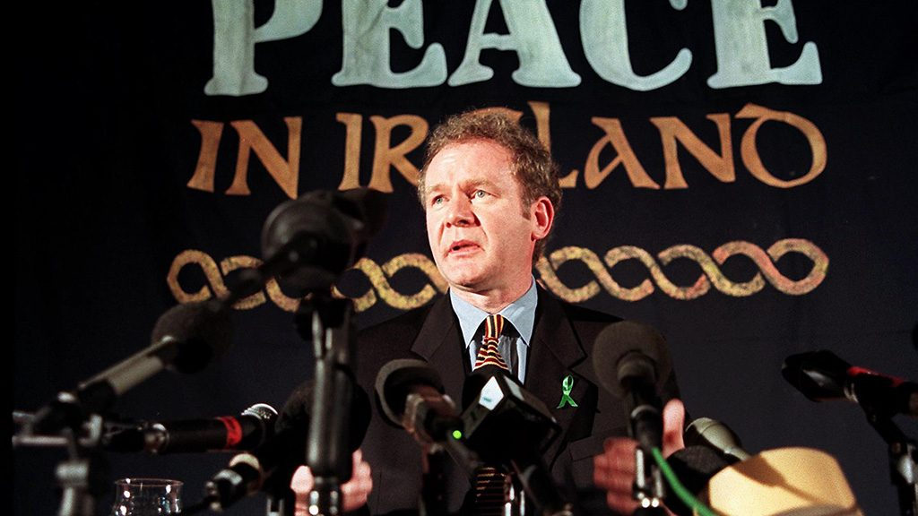 (FILES) This file photo taken on February 26, 1998 shows Sinn Fein chief negotiator Martin McGuinness answering journalists' question during a press conference in London, 26 February 1998. Northern Ireland's former deputy First Minister and one-time IRA commander Martin McGuinness has died aged 66, his Irish nationalist party Sinn Fein said on March 21, 2017. / AFP PHOTO / GERRY PENNY