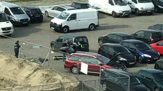 """A picture obtained from the Twitter account of Anouk Leemans shows police standing next to a car after a man tried to drive into a crowd at high-speed in a shopping area in the port city of Antwerp, on March 23, 2017. Belgian security forces arrested the man, who is a French national, and found a rifle as well as bladed weapons in the car. The incident came a day after an attack on the British parliament killed three people plus the attacker, as well as after the first anniversary of the Brussels attacks in which 32 people died.  / AFP PHOTO / Handout / Anouk LEEMANS / RESTRICTED TO EDITORIAL USE - MANDATORY CREDIT """"AFP PHOTO / ANOUK LEEMANS"""" - NO MARKETING NO ADVERTISING CAMPAIGNS - DISTRIBUTED AS A SERVICE TO CLIENTS"""