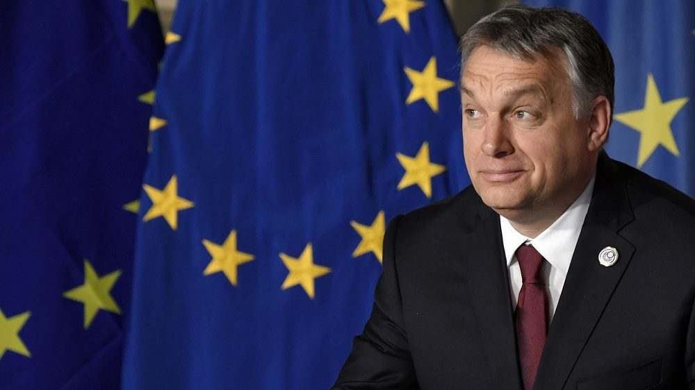 Hungary's prime Minister Viktor Orban signs the new Rome declaration with leaders of 27 European Union countries special during a summit of EU leaders to mark the 60th anniversary of the bloc's founding Treaty of Rome, on March 25, 2017 at Rome's Piazza del Campidoglio (Capitoline Hill).   Against a backdrop of crises and in the absence of the departing Britain, the leaders signed a new Rome declaration, six decades after the six founding members signed the Treaty of Rome and gave birth to the European Economic Community.  / AFP PHOTO / Tiziana FABI