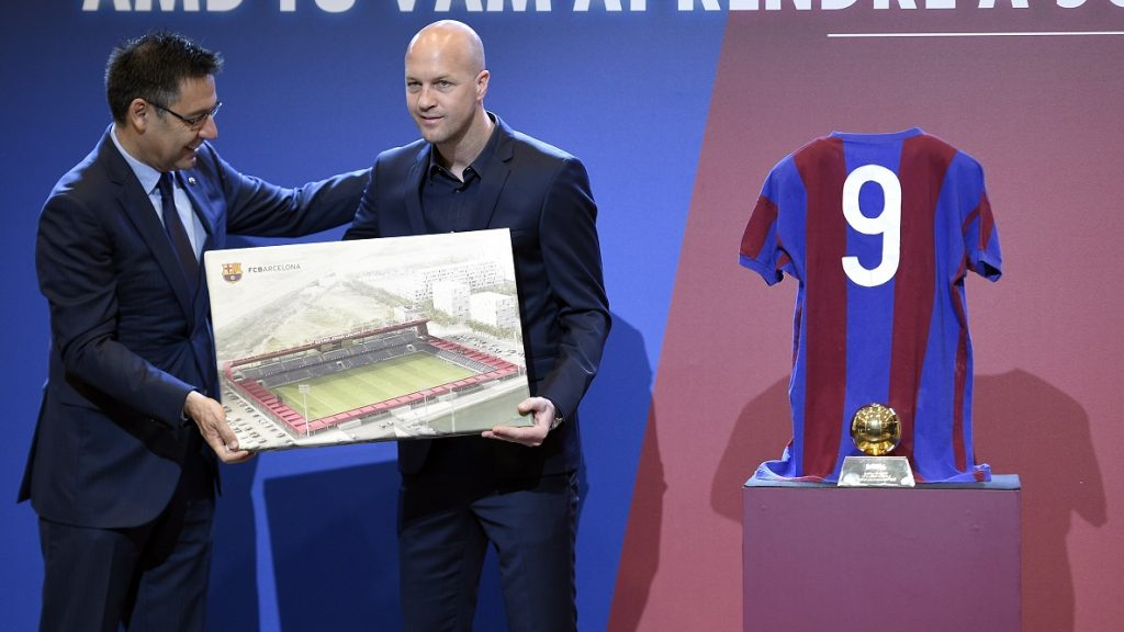 Barcelona's president Josep Maria Bartomeu (L) and son of late Dutch football star Johan Cruyff, Jordi Cruyff pose with a photo of the project of new stadium at Sports Center FC Barcelona Joan Gamper which will be named after Johan Cruyff during a ceremony for the first anniversary of Johan Cruyff's death at Camp Nou stadium  in Barcelona on March 25, 2017. Jordi Cruyff said he was very happy of the agreement reached with FC Barcelona to name the Barca B team stadium after Johan Cruyff and the project of a statue of late football star for the Camp Nou, both in honour of his father. Johan Cruyff, one of the greatest footballers of all time who dazzled with his artistry, died on March 24, 2016 at the age of 68 after losing a battle with lung cancer, prompting an avalanche of tributes from around the sports world. / AFP PHOTO / LLUIS GENE