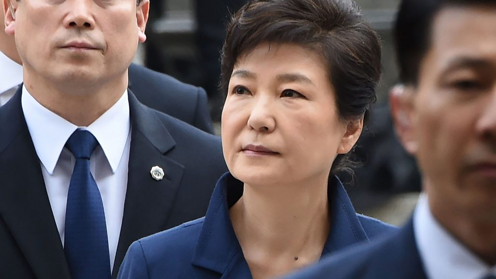 South Korea's ousted president Park Geun-Hye (C) arrives for a hearing to decide whether she should be arrested over the corruption and abuse of power scandal that brought her down, at a court in Seoul on March 30, 2017. Her formal detention and transfer to custody would be a key step in the disgrace of South Korea's first woman president, who secured the largest vote share of any candidate in the democratic era when she was elected in 2012. Park had her removal from office confirmed by the country's top court earlier this month, ending her executive immunity, and her prosecution has been a key demand of the millions of people who took to the streets to protest against her.  / AFP PHOTO / YONHAP / YONHAP / REPUBLIC OF KOREA OUT  NO ARCHIVES  RESTRICTED TO SUBSCRIPTION USE