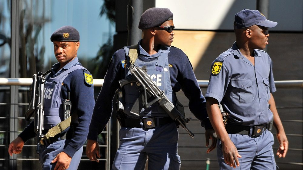 South African police patrol outside a hotel at Johannesburg Airport where relatives of the passengers killed in the Afriqiyah Airways Airbus A330 are gathered on May 12, 2010. A Libyan plane arriving from South Africa disintegrated on landing at Tripoli airport on May 12, killing 103 people but leaving a child as the sole miracle survivor, officials said.           AFP PHOTO / Alexander Joe / AFP PHOTO / ALEXANDER JOE