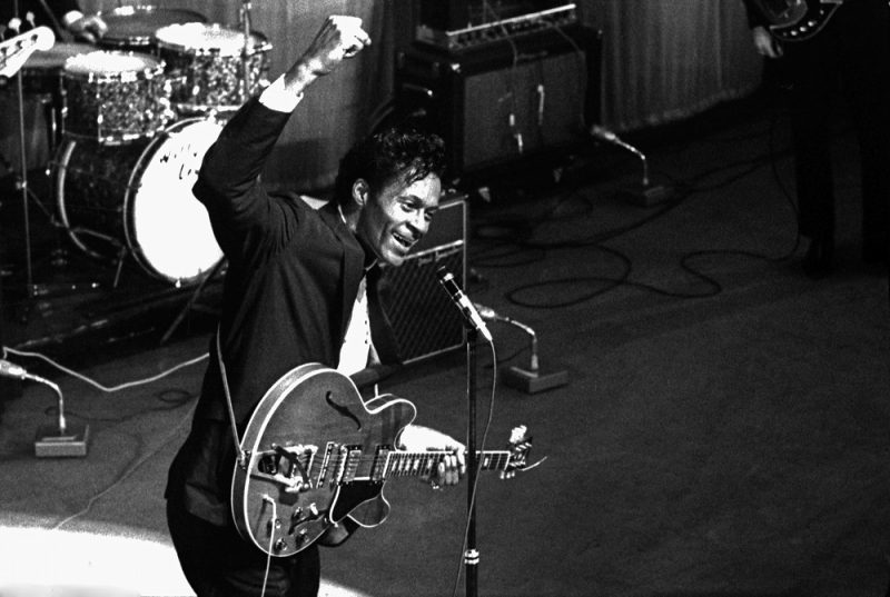American singer and guitar player Chuck Berry during a concert at the Olympia Hall in Paris in 1964. Photo André Crudo