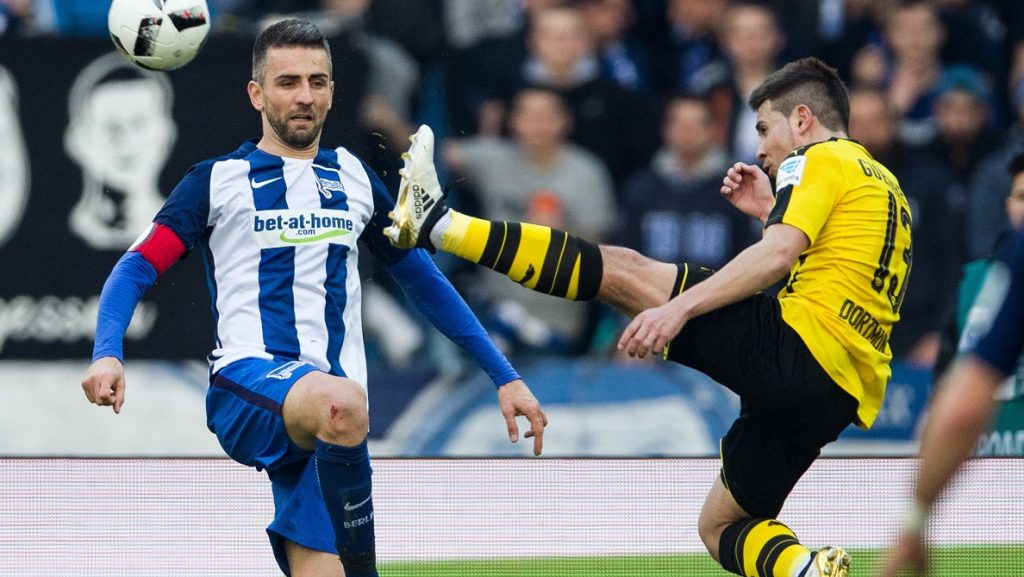 Hertha's Vedad Ibisevic (L) and Dortmund's Raphael Guerreiro (L) vie for the ball during the German Bundesliga soccer match between Hertha BSC and Borussia Dortmund in the Olympic Stadium in Berlin, Germany, 11 March 2017.  (EMBARGO CONDITIONS - ATTENTION: Due to the accreditation guidelines, the DFL only permits the publication and utilisation of up to 15 pictures per match on the internet and in online media during the match.) Photo: Soeren Stache/dpa
