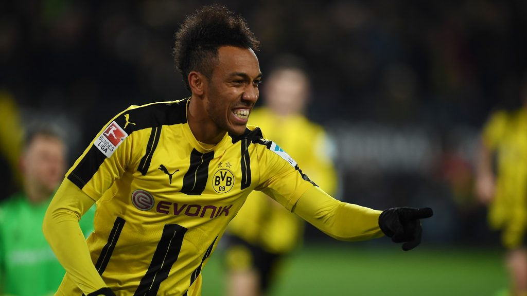 Dortmund's Gabonese forward Pierre-Emerick Aubameyang celebrates scoring the opening goal with his teammates during the German First division Bundesliga football match BVB Borussia Dortmund vs FC Ingolstadt in Dortmund, western Germany on March 17, 2017. / AFP PHOTO / PATRIK STOLLARZ / RESTRICTIONS: DURING MATCH TIME: DFL RULES TO LIMIT THE ONLINE USAGE TO 15 PICTURES PER MATCH AND FORBID IMAGE SEQUENCES TO SIMULATE VIDEO. == RESTRICTED TO EDITORIAL USE == FOR FURTHER QUERIES PLEASE CONTACT DFL DIRECTLY AT + 49 69 650050