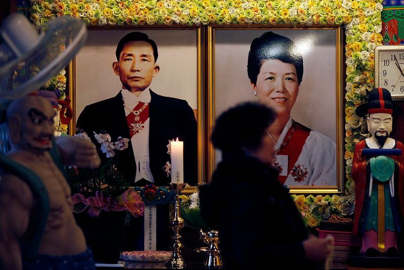 SEOUL, SOUTH KOREA - NOVEMBER 26:  The portraits of former president Park Chung-hee and his wife Yuk Young-soo, president Park Geun-hye's parents, are exhibited in the temple on November 26, 2016 in the city center of Seoul, South Korea. The President Park Geun-hye has recorded worst ever polling figures for the country's presidency after her friend Choi Soon-sil was charged with corrupt influence over state affairs.  (Photo by Woohae Cho/Getty Images)