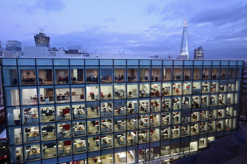 LONDON, ENGLAND - FEBRUARY 06:  People work at dusk on various floors of the modern office development at 20 Cannon Street near St Paul's Cathedral on February 06, 2013 in London, England. A recent study of European working hours has shown that British men have the longest working week of any European Union country.  (Photo by Oli Scarff/Getty Images)