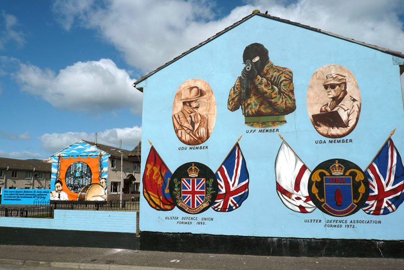 A loyalist mural on painted on the end of a row of houses on the Lower Shankhill estate in Belfast. This area of the city was a loyalist stronghold during the Troubles in the Province. Since the 1998 Good Friday agreement which instigated peace in Northern Ireland, the area became popular with tourists wishing to visit past trouble spots. (Photo by Colin McPherson/Corbis via Getty Images)