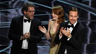 HOLLYWOOD, CA - FEBRUARY 26:  (L-R) Producer Gary Gilbert, actors Emma Stone and Ryan Gosling celebrate 'La La Land' winning Best Picture due to a presentation error (the actual winner was later announced as 'Moonlight') onstage during the 89th Annual Academy Awards at Hollywood & Highland Center on February 26, 2017 in Hollywood, California.  (Photo by Kevin Winter/Getty Images)