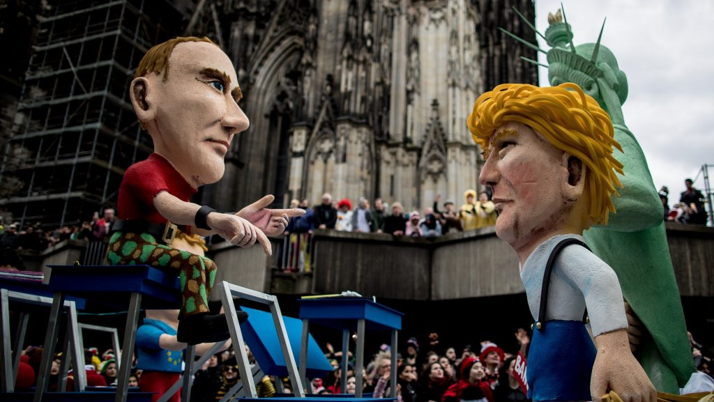 COLOGNE, GERMANY - FEBRUARY 27: A float featuring U.S. President Donald Trump and Russian President Vladimir Putin drives in the annual Rose Monday parade next to the Cathedral on February 27, 2017 in Cologne, Germany. Political satire is a traditional cornerstone of the annual parades and the ascension of Donald Trump to the U.S. presidency, the rise of the populist far-right across Europe and the upcoming national elections in Germany provided rich fodder for float designers this year. (Photo by Maja Hitij/Getty Images)