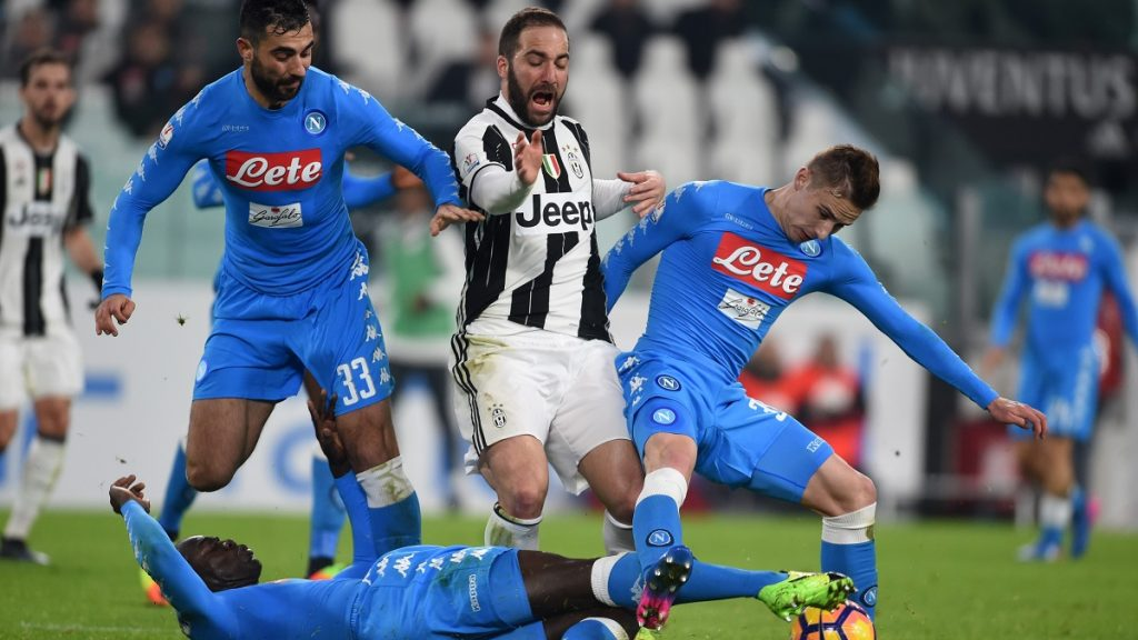 TURIN, ITALY - FEBRUARY 28: Gonzalo Higuain (2nd R) of FC Juventus in action against Raul Albiol (L) of SSC Napoli during the TIM Cup match between Juventus FC and SSC Napoli at Juventus Stadium in Turin, Italy on February 28, 2017. Pier Marco Tacca / Anadolu Agency