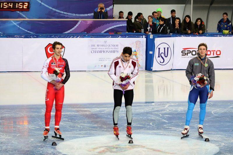 ERZURUM, TURKEY - MARCH 8:  Men's 500m speed skating medalists, from left, Canada's Girard Samuel, silver, Hungary's Liu Shaolin Sandor, gold, and Kazakhistan's Nikisha Denis, bronze, during the medals ceremony at ISU World Junior Short Track Speed Skating Championships in Erzurum, Turkey, on March 8, 2014. Ahmet Okatali / Anadolu Agency