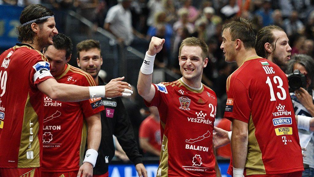 Veszprém's Laszlo Nagy (L-R) Gasper Marguc and Momir Ilic celebrate after the Handball EHF Champions League final Four semi-final match between THW Kiel and MVM Veszprem in Cologne, western Germany, on May 28, 2016.  / AFP PHOTO / SASCHA SCHUERMANN