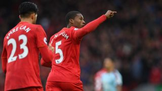Liverpool's Dutch midfielder Georginio Wijnaldum celebrates after scoring their first goal during the English Premier League football match between Liverpool and Burnley at Anfield in Liverpool, north west England on March 12, 2017. / AFP PHOTO / Paul ELLIS / RESTRICTED TO EDITORIAL USE. No use with unauthorized audio, video, data, fixture lists, club/league logos or 'live' services. Online in-match use limited to 75 images, no video emulation. No use in betting, games or single club/league/player publications.  /