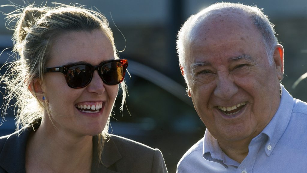 Founder and chairman of the Inditex fashion group Amancio Ortega (R) laughs with his daughter Marta Ortega at the end of the 32nd edition of the A Coruna International Show Jumping competition at the Casas Novas Equestrian Centre in Arteixo, on July 31, 2016.  / AFP PHOTO / MIGUEL RIOPA
