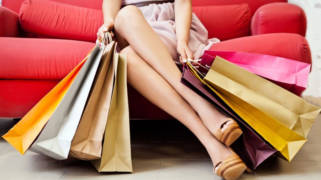 A woman with many shopping bags.
