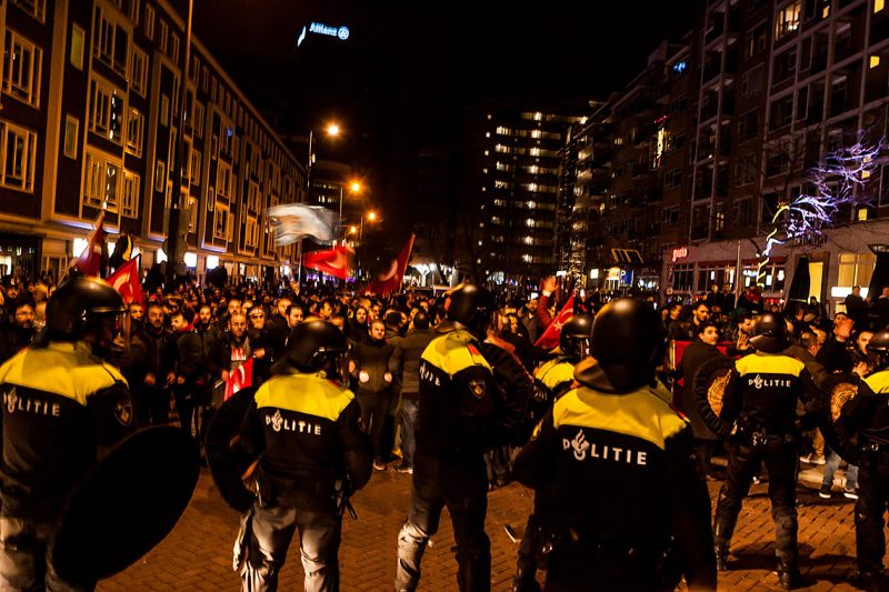 ROTTERDAM, NETHERLANDS - MARCH 12: Dutch police intervene the Turkish citizens gathering outside Turkish consulate in Rotterdam to protest Dutch government after its ban on ministers, in Rotterdam, Netherlands on March 12, 2017. The Dutch government on Saturday canceled the flight permit for Turkish Foreign Minister's Mevlut Cavusoglu and blocked Turkish Family Minister Fatma Betul Sayan Kayas convoy from entering the Turkish consulate in Rotterdam.  (Photo by Paco Nunez/Anadolu Agency/Getty Images)