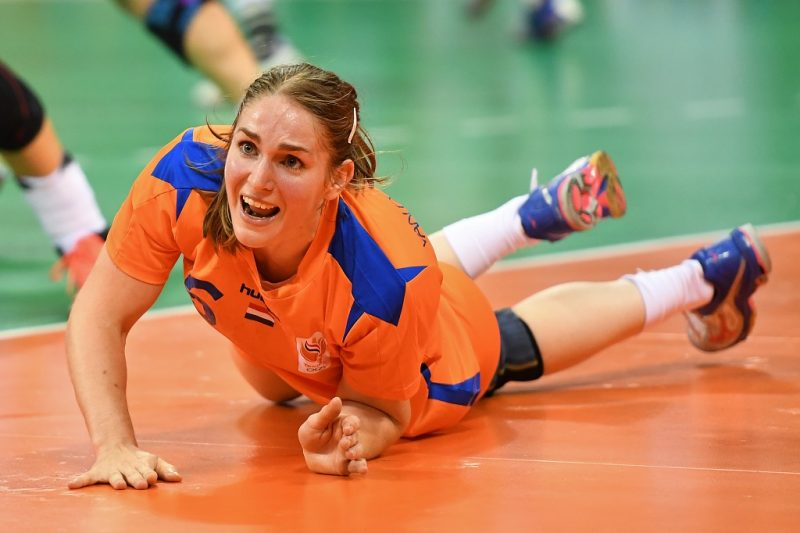 Netherlands' right back Laura van der Heijden reacts as she lies on the floor during the women's Bronze Medal handball match Netherlands vs Norway for the Rio 2016 Olympics Games at the Future Arena in Rio on August 20, 2016. / AFP PHOTO / Roberto SCHMIDT