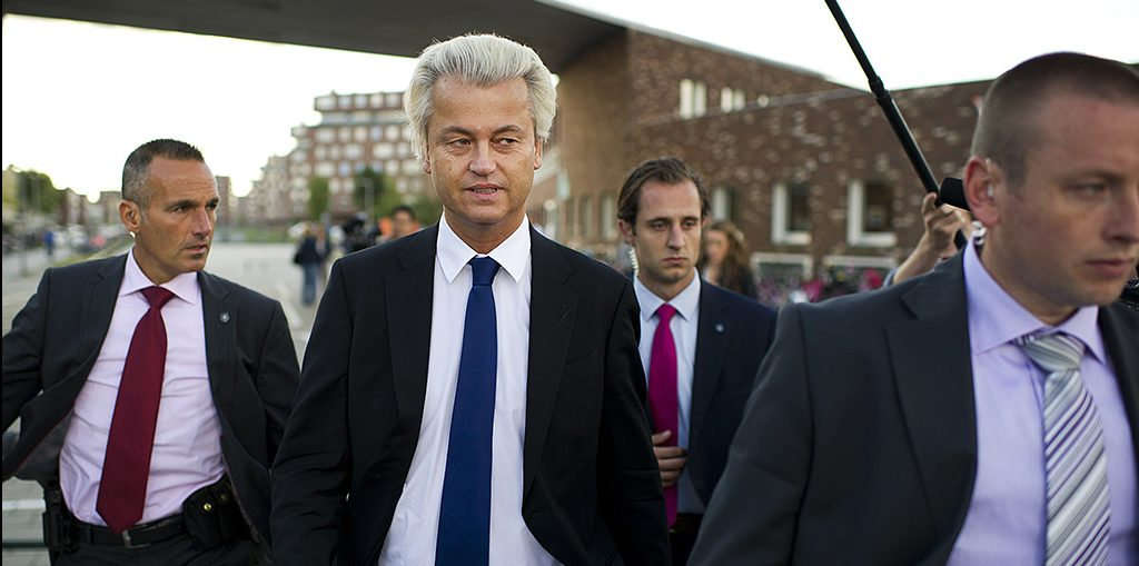 THE HAGUE, NETHERLANDS - SEPTEMBER 12:  Geert Wilders of the Freedom Party (PVV) walks in between security men after casting his ballot for the Dutch parliamentary elections in a polling station on September 12, 2012 in The Hague, Netherlands. The Dutch are going to the polls today to vote for the 150 seats in Paliament.  (Photo by Jasper Juinen/Getty Images)