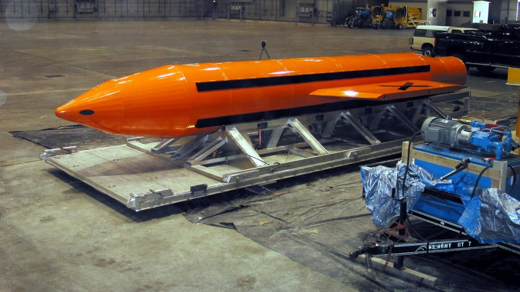 This photo released by the US Defense Department (DOD) 11 March, 2003, shows a Massive Ordnance Air Blast (MOAB) weapon being prepared for testing, at the Eglin Air Force Armament Center on March 11, 2003. The conventional MOAB is a satellite guided bomb, weighing 21,500-pound (9,752 kilo) according to DOD, that was dropped from a US Air Force C-130 cargo aircraft 11 March. It will be the largest non-nuclear conventional weapon in existence.   AFP PHOTO/DOD / AFP PHOTO / DOD