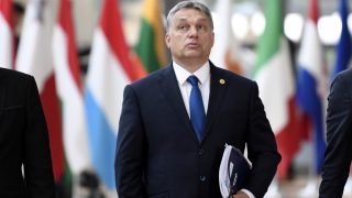 """Hungary's Prime minister Viktor Orban arrives to take part in the EU summit at the new """"Europa"""" building in Brussels on March 9, 2017.  / AFP PHOTO / STEPHANE DE SAKUTIN"""