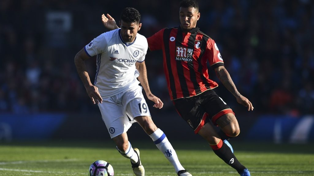 Bournemouth's Norwegian striker Joshua King (R) chases Chelsea's Brazilian-born Spanish striker Diego Costa (L) during the English Premier League football match between Bournemouth and Chelsea at the Vitality Stadium in Bournemouth, southern England on April 8, 2017. / AFP PHOTO / Glyn KIRK / RESTRICTED TO EDITORIAL USE. No use with unauthorized audio, video, data, fixture lists, club/league logos or 'live' services. Online in-match use limited to 75 images, no video emulation. No use in betting, games or single club/league/player publications.  /