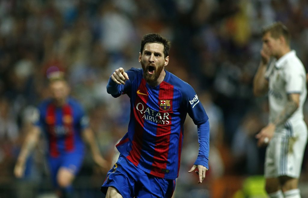 Barcelona's Argentinian forward Lionel Messi celebrates after scoring during the Spanish league Clasico football match Real Madrid CF vs FC Barcelona at the Santiago Bernabeu stadium in Madrid on April 23, 2017. / AFP PHOTO / OSCAR DEL POZO
