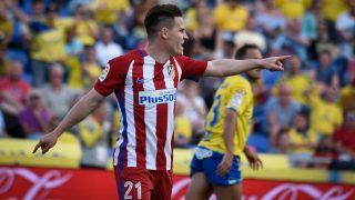 Atletico Madrid's French forward Kevin Gameiro celebrates after scoring during the Spanish league football match UD Las Palmas vs Club Atletico de Madrid at the Gran Canaria stadium in Las Palmas de Gran Canaria on April 29, 2017. / AFP PHOTO / DESIREE MARTIN