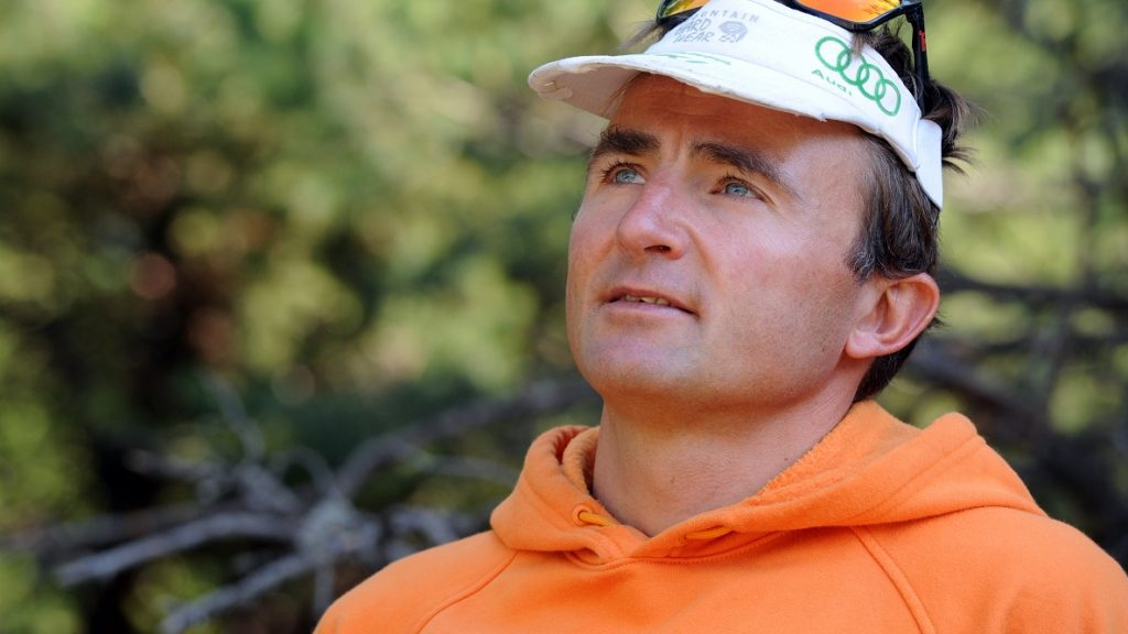 Swiss climber Ueli Steck poses in Sigoyer, in the Hautes-Alpes department of southeastern France, on August 13, 2015. Steck announced on August 12 that he had completed the ascent of 82 Alpine peaks of over 4,000 meters in 62 days after having climbed the Barre des Ecrins mountain in the French Alps. Stecks goal was to connect all 82 summits in less than 80 days and his expedition took him through the Swiss, French and Italian Alps without using any motorized means. AFP PHOTO / JEAN-PIERRE CLATOT / AFP PHOTO / JEAN-PIERRE CLATOT