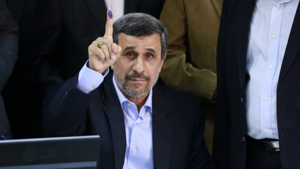 IRAN, Tehran: Former Iranian president Mahmoud Ahmadinejad shows off his inked finger at the Interior Ministry's election headquarters after registering to run for the upcoming presidential elections in Tehran on April 12, 2017.  - Rouzbeh Fouladi