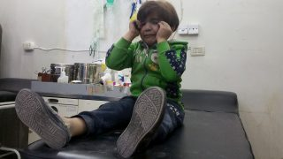 IDLIB, SYRIA - APRIL 4: A child gets treatment at a hospital after Assad Regime forces attacked with suspected chlorine gas to Khan Shaykhun town of Idlib, Syria on April 4, 2017. Bahjat Najar / Anadolu Agency