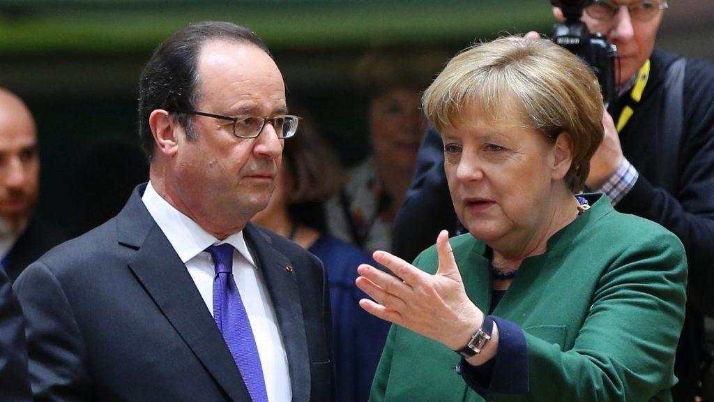 BRUSSELS, BELGIUM - MARCH 10 : German Chancellor Angela Merkel (R) talks with French President Francois Hollande (L) during the European Union (EU) Leaders Summit in Brussels, Belgium on March 10, 2017. Dursun Aydemir / Anadolu Agency