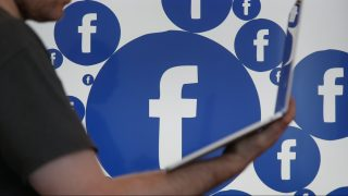 A Facebook logo is seen on various electronic devices on 28 March, 2017. (Photo by Jaap Arriens/NurPhoto)