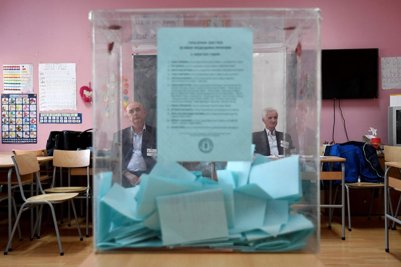 Electoral committee members sit at a polling station, in Belgrade, on April 2, 2017. Serbians head to the polls to elect a new president, with strongman Aleksandar Vucic hoping to tighten his grip on power amid opposition accusations he is shifting the country to authoritarian rule. / AFP PHOTO / ANDREJ ISAKOVIC