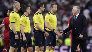 Bayern Munich's Italian head coach Carlo Ancelotti shakes hands with referees at the end of the UEFA Champions League quarter-final second leg football match Real Madrid vs FC Bayern Munich at the Santiago Bernabeu stadium in Madrid in Madrid on April 18, 2017. / AFP PHOTO / JAVIER SORIANO