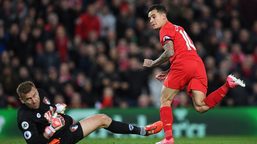 Liverpool's Brazilian midfielder Philippe Coutinho (R) watches hsi shot beat Bournemouth's Polish goalkeeper Artur Boruc as Liverpool make the score 1-1 during the English Premier League football match between Liverpool and Bournemouth at Anfield in Liverpool, north west England on April 5, 2017. / AFP PHOTO / Paul ELLIS / RESTRICTED TO EDITORIAL USE. No use with unauthorized audio, video, data, fixture lists, club/league logos or 'live' services. Online in-match use limited to 75 images, no video emulation. No use in betting, games or single club/league/player publications.  /