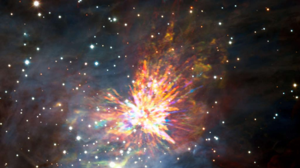 Stellar explosions are most often associated with supernovae, the spectacular deaths of stars. But new ALMA observations of the Orion Nebula complex provide insights into explosions at the other end of the stellar life cycle, star birth. Astronomers captured these dramatic images of the remains of a 500-year-old explosion as they explored the firework-like debris from the birth of a group of massive stars, demonstrating that star formation can be a violent and explosive process too. The background image includes optical and near-infrared imaging from both the Gemini South and ESO Very Large Telescope. The famous Trapezium Cluster of hot young stars appears towards the bottom of this image. The ALMA data do not cover the full image shown here.