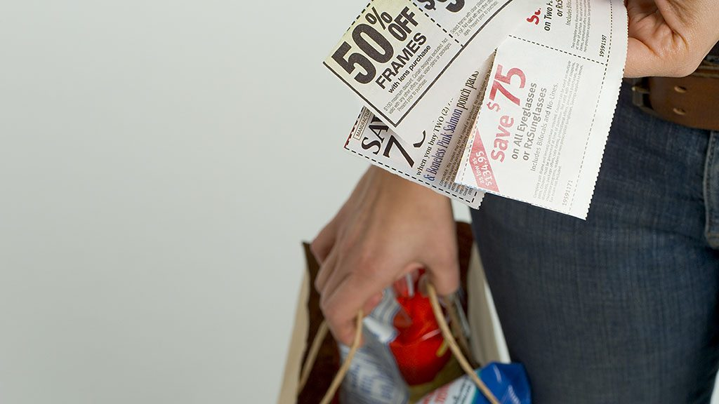 Woman with coupons and groceries