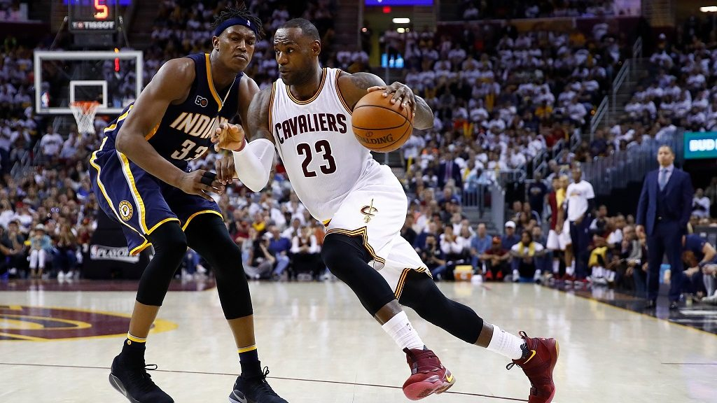 CLEVELAND, OH - APRIL 15: LeBron James #23 of the Cleveland Cavaliers drives around Myles Turner #33 of the Indiana Pacers during the second half in Game One of the Eastern Conference Quarterfinals during the 2017 NBA Playoffs at Quicken Loans Arena on April 15, 2017 in Cleveland, Ohio. Cleveland won the game 109-108 to take a 1-0 series lead. NOTE TO USER: User expressly acknowledges and agrees that, by downloading and or using this photograph, User is consenting to the terms and conditions of the Getty Images License Agreement.   Gregory Shamus/Getty Images/AFP